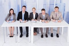 Corporate personnel officers sitting at table stock photos