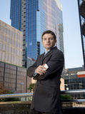 Corporate portrait attractive businessman outdoors urban office buildings Stock Photos