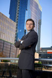 Corporate portrait attractive businessman outdoors urban office buildings Royalty Free Stock Photo
