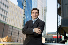 Corporate portrait attractive businessman standing outdoors urban office buildings Royalty Free Stock Images