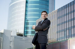 Corporate portrait businessman smiling happy confident standing outdoors Stock Image