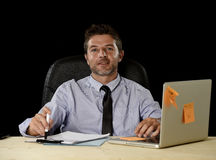 Corporate portrait happy successful businessman smiling at office desk working with laptop computer Stock Image
