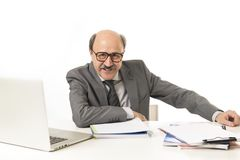 Corporate portrait of 60s bald happy business man smiling confid Royalty Free Stock Images