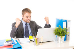 Corporate portrait of young attractive businessman gesturing and celebrating business success excited Stock Images