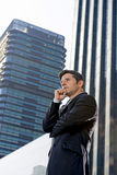 Corporate portrait young attractive businessman standing outdoor Stock Image