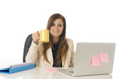 Corporate portrait young attractive businesswoman at office chair working at laptop computer desk Stock Photos