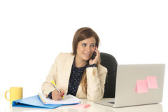 Corporate portrait young attractive businesswoman at office chair working at laptop computer desk Royalty Free Stock Images