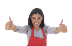 Corporate portrait of young attractive hispanic home cook woman in red apron posing happy and smiling isolated Royalty Free Stock Photography