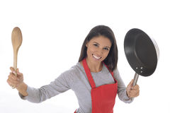 Corporate portrait of young attractive hispanic home cook woman in red apron posing happy and smiling isolated Stock Photos