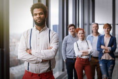Corporate portrait of young black hipster businessman with his colleagues in background Stock Photography