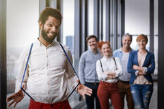 Corporate portrait of young black hipster businessman stretching braces Royalty Free Stock Image