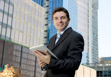 Corporate portrait young businessman working with digital tablet outdoors Royalty Free Stock Photos