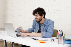 Corporate portrait young hispanic attractive hipster businessman working with computer modern home office stock image