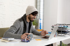 Corporate portrait young hispanic attractive hipster businessman working with computer modern home office Royalty Free Stock Photos