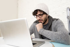 Corporate portrait young hispanic attractive hipster businessman working with computer modern home office Royalty Free Stock Image