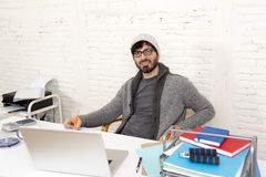 Corporate portrait young hispanic attractive hipster businessman working with computer modern home office Stock Photos