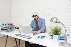 Corporate portrait of young hispanic attractive hipster businessman working at modern home office Stock Image