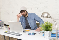 Corporate portrait of young hispanic attractive hipster businessman working at modern home office Stock Photos