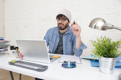 Corporate portrait of young hispanic attractive hipster businessman working at modern home office Stock Images