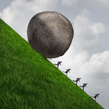 Corporate Pressure. Business concept as a huge boulder rock rolling down a hill with running businesswomen and businessmen as an economic risk and danger Royalty Free Stock Photo