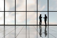 Corporate Profiles. Profiles of two business people against a bank of windows in an office tower stock illustration
