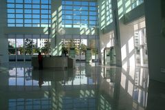 Corporate reflections. Modern business building interior with reflections Stock Image