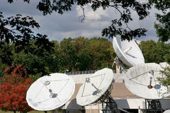 Corporate satellite dishes in autumn Royalty Free Stock Images