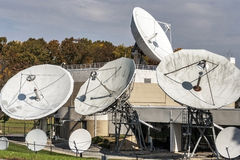 Corporate satellite dishes in a rural office complex Royalty Free Stock Photo