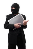 Corporate Secrets. A thief wearing a black suit is stealing corporate secrets, isolated against a white background Stock Photography