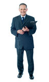 Corporate senior holding business documents stock photography
