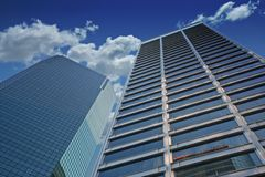 Corporate skyscrapers. Under a dramatic blue sky Royalty Free Stock Photos