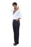 Corporate smiling woman pointing away Royalty Free Stock Photo