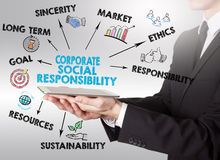 Corporate Social Responsibility Concept, young man holding a tab Royalty Free Stock Photo