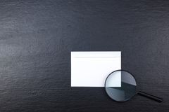 Business card. Corporate stationery set mockup. Blank textured brand ID elements on wooden table. Magnifier. Top view. Stock Photos