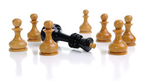 Corporate strategy. Lonely king against pawns. On a white background Royalty Free Stock Image