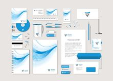 Corporate style with a blue wave and the abstract sign. The light corporate style with a blue wave and the abstract sign. Samples of business cards, a disk, a Royalty Free Stock Image