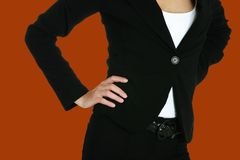 Corporate suit 585a. Business woman in black suit on bright orange background, clipping path included royalty free stock photo