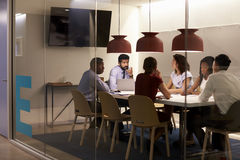 Corporate team at table in a meeting room cubicle, close up Stock Photos
