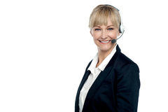 Corporate telecaller smiling confidently Royalty Free Stock Photography