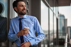 One male worker drinking coffee on office balcony stock photography