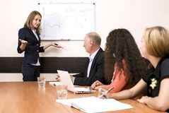 Corporate training. Female Instructor delivers the topic to participants of corporate training stock photos