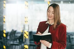 Corporate training successful professional career. Corporate training. Successful professional career. Business woman standing at conference hall, taking notes royalty free stock image