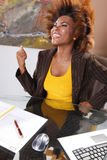 Corporate victory. Corporate executive claims victory at her desk Royalty Free Stock Photography