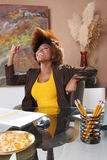 Corporate victory. Corporate executive claims victory at her desk Stock Images