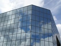 Corporate Vision. Office building exterior with reflected clouds Royalty Free Stock Image