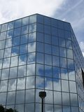 Corporate Vision. Office building with reflected clouds Stock Photography