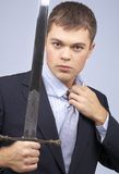Corporate warrior. Portrait of aggressive corporate worker with sword Stock Photo