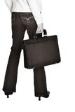 Corporate woman 584. Young businesswoman with a case standing with her back, soft sepia finish stock image
