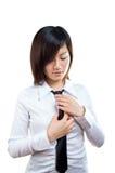 Corporate woman adjusting her necktie Stock Photos