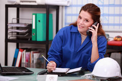 Corporate woman answering  phone Royalty Free Stock Photo